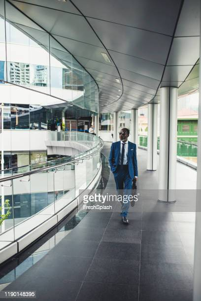 businessman walking confidently - ambassador stock pictures, royalty-free photos & images