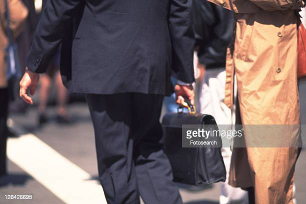 Businessman walking down on street, rear view, New York City, NY, USA