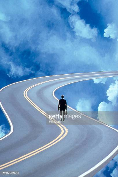 Businessman Walking Down Road to Success