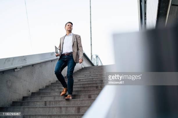 businessman walking down stairs - 下方 ストックフォトと画像