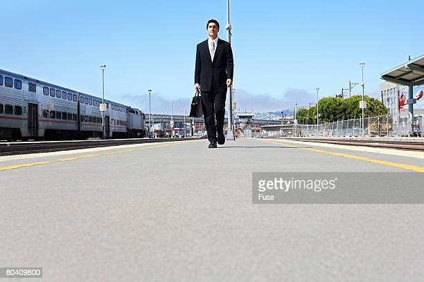 Businessman Walking from Train Station