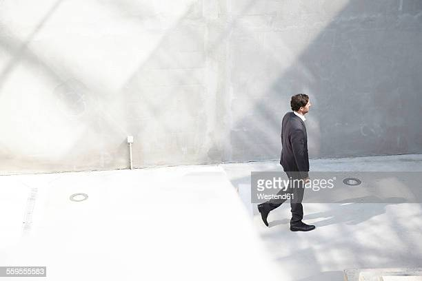 Businessman walking in a modern building