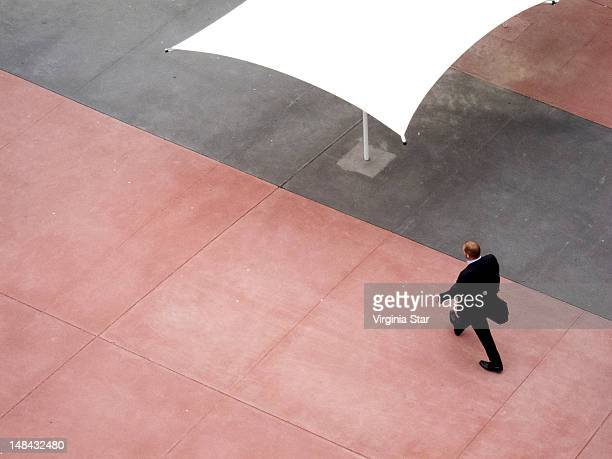 Businessman walking in city with briefcase