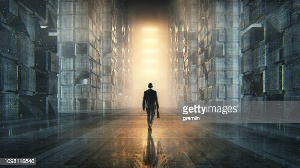 businessman walking in dark futuristic city - mystery stock pictures, royalty-free photos & images