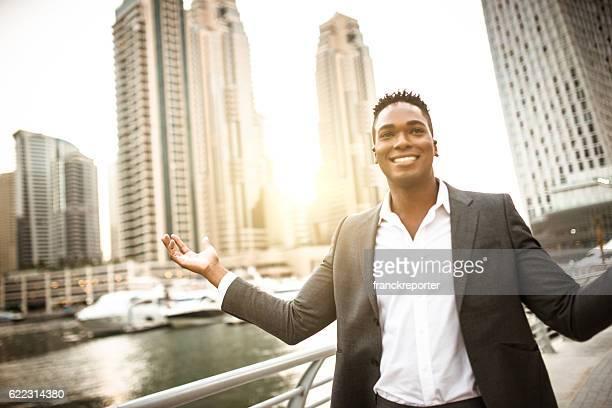 Businessman walking in dubai marina