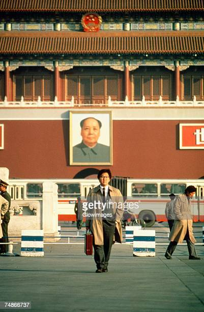 Businessman walking in front of a palace, Tiananmen Gate Of Heavenly Peace, Tiananmen Square, Beijing, China