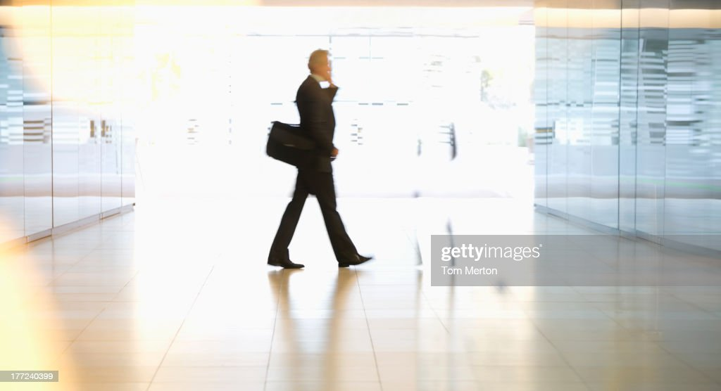 Businessman walking in lobby : Stock Photo