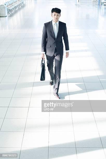 Businessman walking indoors, Fukuoka Prefecture, Kyushu, Japan
