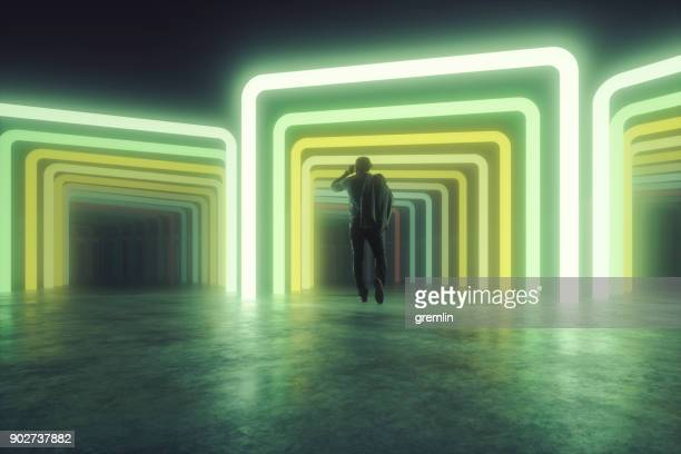 businessman walking into the uncertain future - illuminated stock pictures, royalty-free photos & images