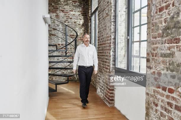 Businessman walking on modern office floor
