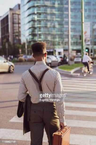 businessman walking on pedestrian crossing, milano, lombardia, italy - サスペンダー ストックフォトと画像