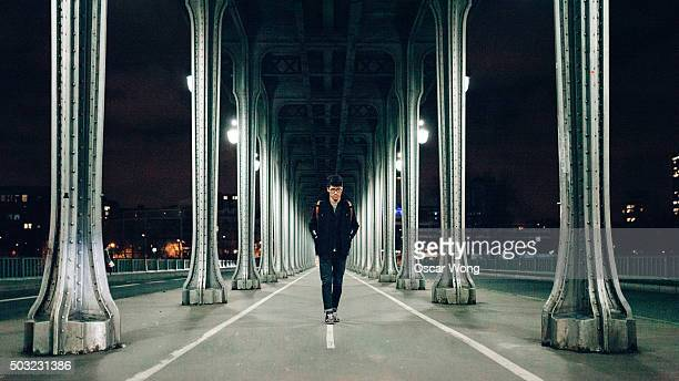 Businessman walking on Pont de Bir-Hakeim