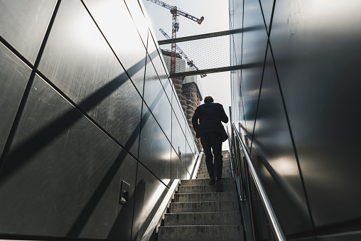 Businessman walking on staircase in the city - gettyimageskorea