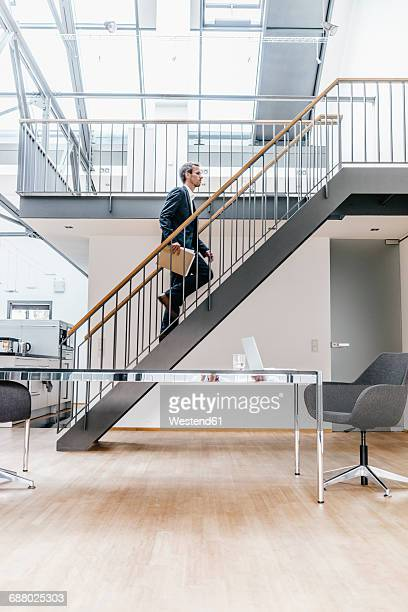 Businessman walking on stairs in a loft