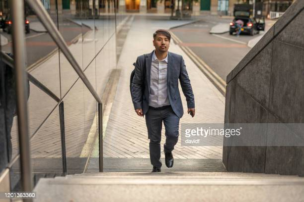 businessman walking on stairs - staircase stock pictures, royalty-free photos & images