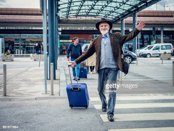 businessman walking on street - waving stock pictures, royalty-free photos & images
