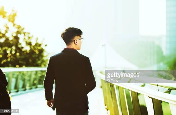 Businessman walking on the bridge