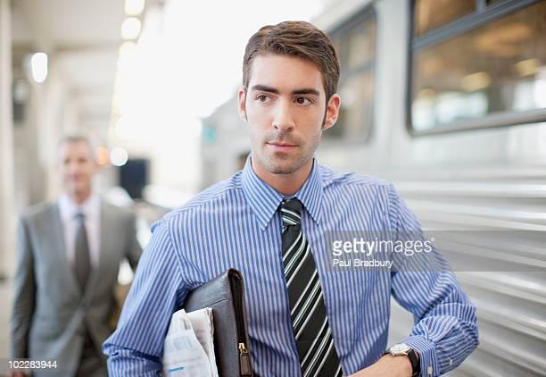 Businessman walking on train platform