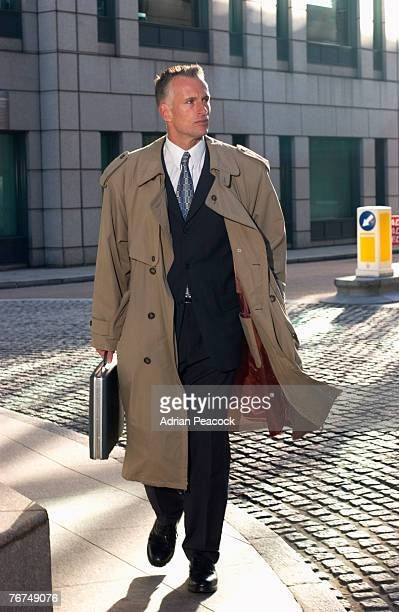 businessman walking - overcoat stock pictures, royalty-free photos & images