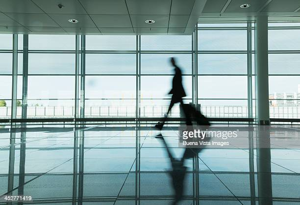 Businessman walking through an airport hall