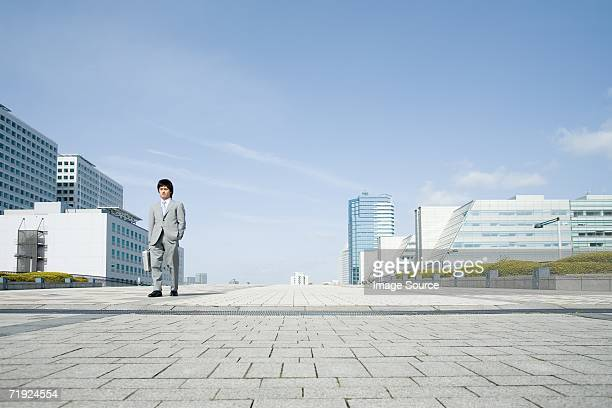 Businessman walking through financial district