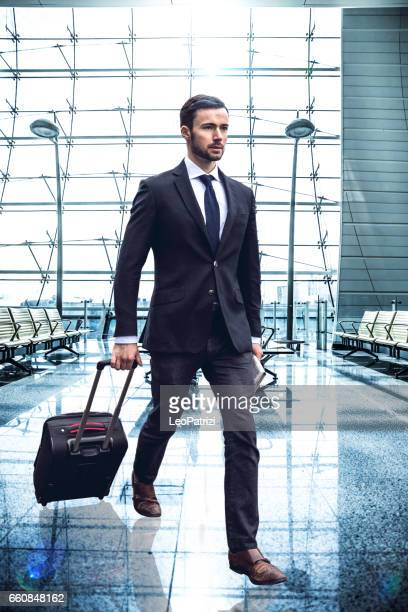 Businessman walking to the gate at the Airport waiting lounge