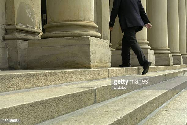 businessman walking up stairs - courthouse stock pictures, royalty-free photos & images