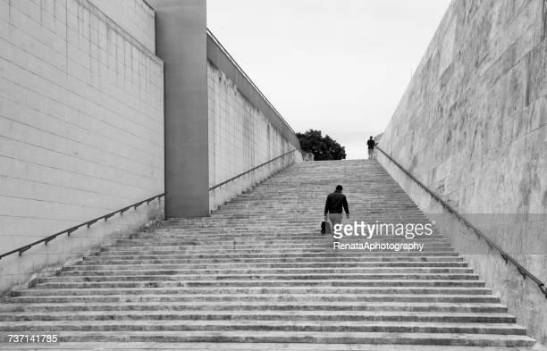 Businessman walking up steps, Valletta, Malta