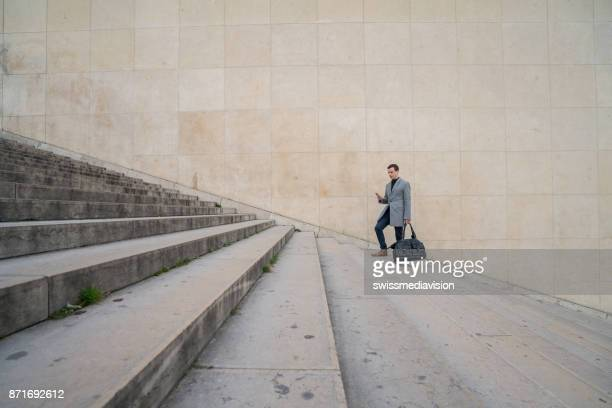Businessman walking up the stairs in the city
