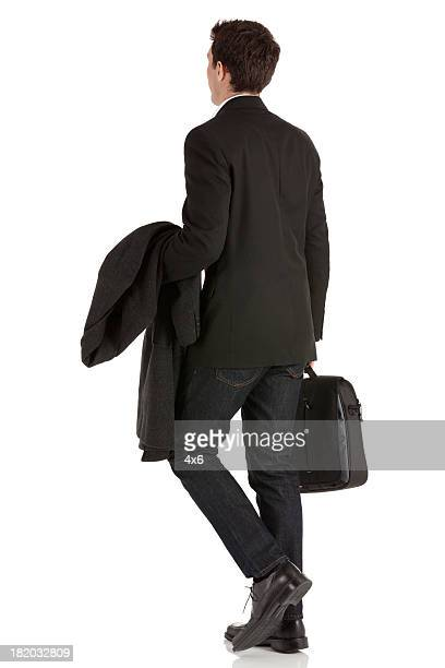 Businessman walking with a briefcase