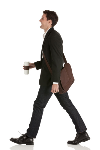 Businessman walking with a disposable cup - gettyimageskorea