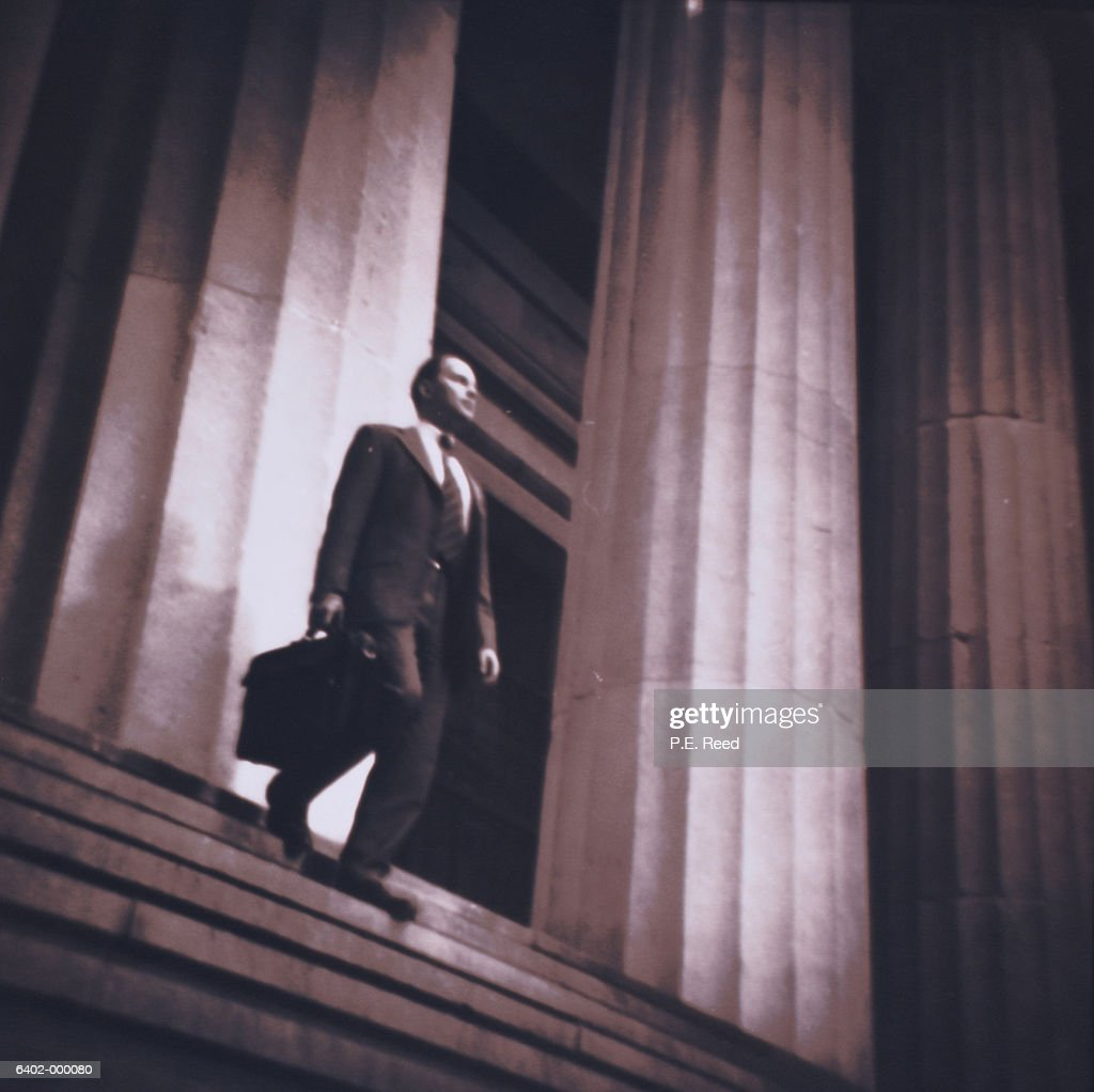 Businessman Walks Down Steps : Stock Photo
