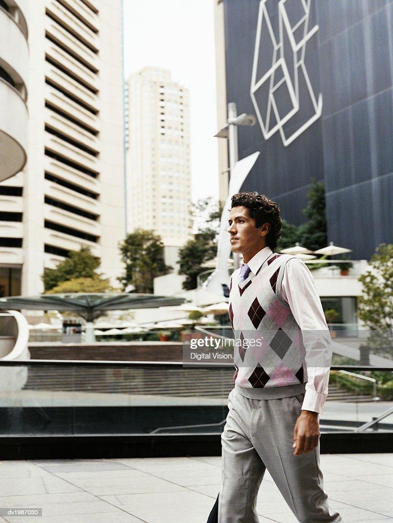 Businessman Walks in a Urban Setting : Stock Photo
