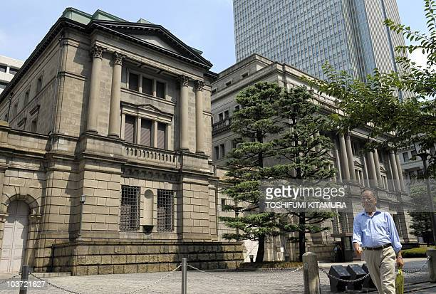 A businessman walks in front of the Bank of Japan headquarters in Tokyo on August 30 2010 The US dollar rose against the yen in Asia as the Bank of...