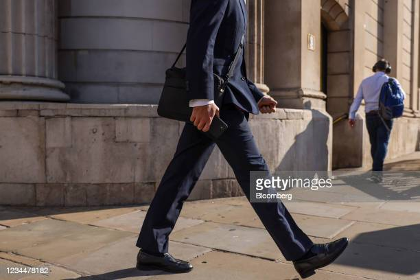 Businessman walks past the Bank of England in the City of London, U.K., on Thursday, Aug. 5, 2021. The Bank of England may move a step closer to...