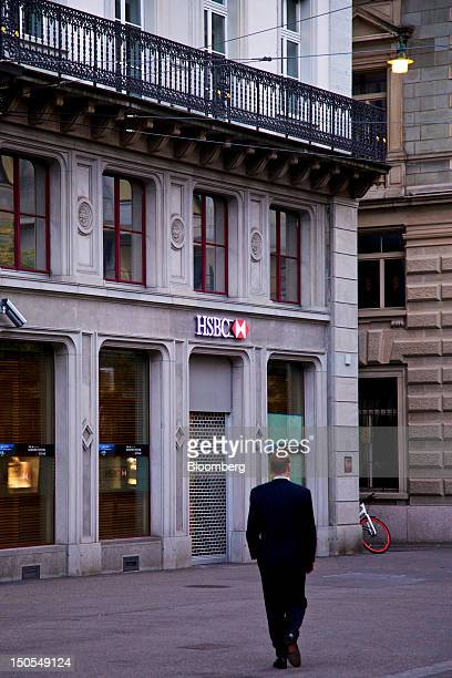 A businessman walks towards an HSBC Holdings Plc bank branch in Zurich Switzerland on Monday Aug 20 2012 At least five Swiss banks supplied emails...
