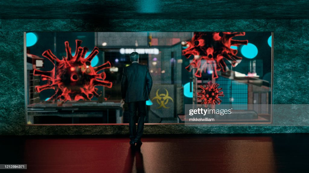 Businessman watches epidemic spread of virus in a city from a window : Stock Photo
