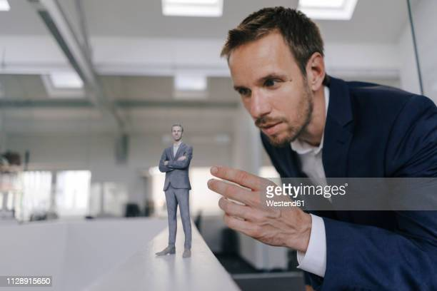 businessman watching his ßd portrait - cloning stock pictures, royalty-free photos & images