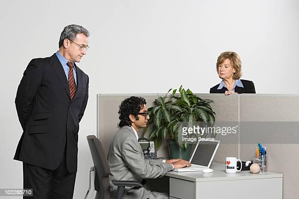 Businessman watching over work