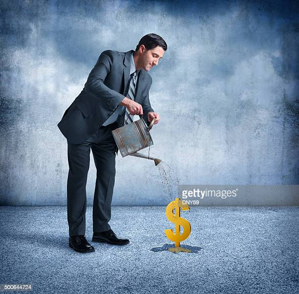 Businessman Watering A Dollar Sign
