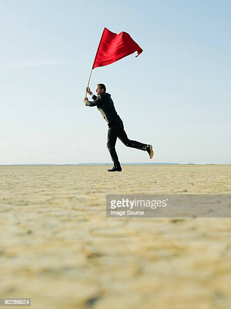 Businessman waving a red flag