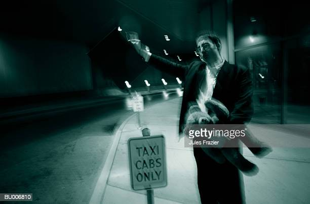 Businessman Waving for Taxi