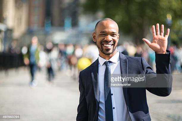 businessman waving hand in london