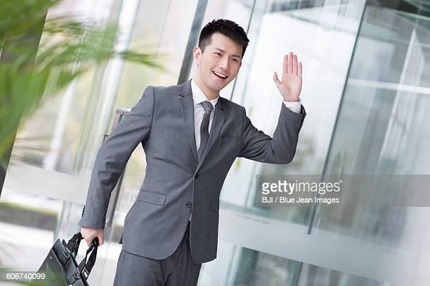 Businessman waving