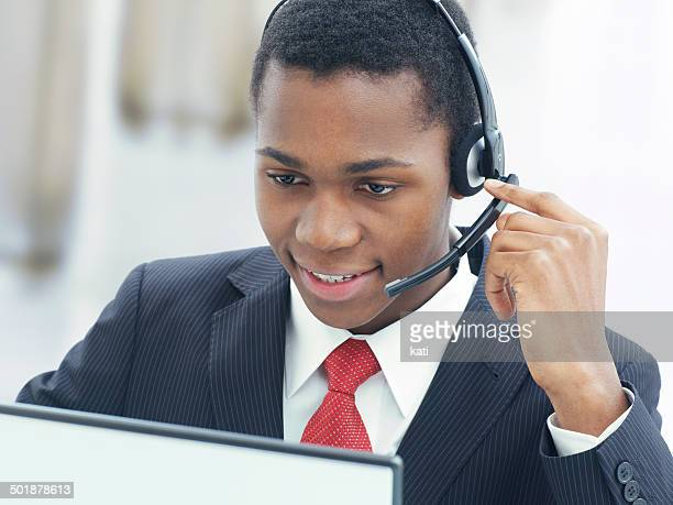 Businessman, wearing a headset in an office