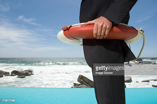 Businessman wearing a lifebelt