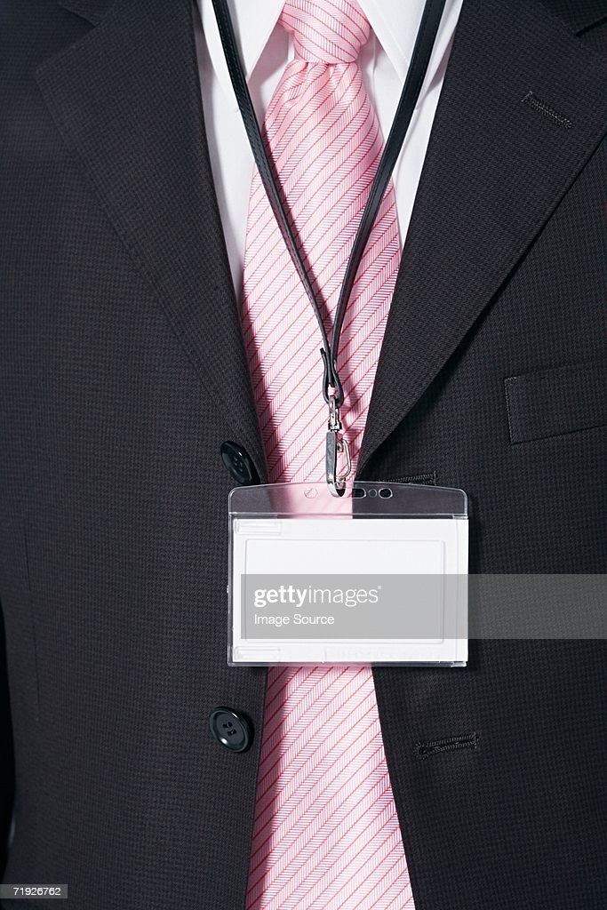 Businessman wearing a security pass : Stock Photo