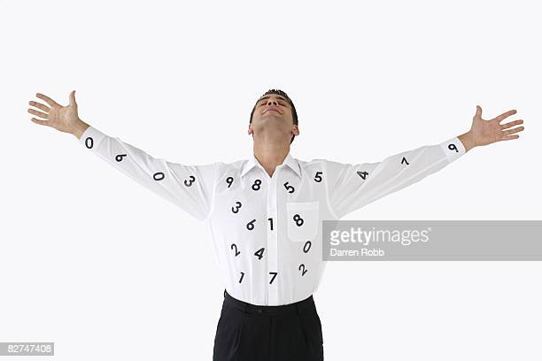 Businessman wearing a white shirt with numbers on