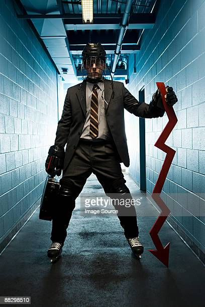 Businessman wearing an ice hockey uniform