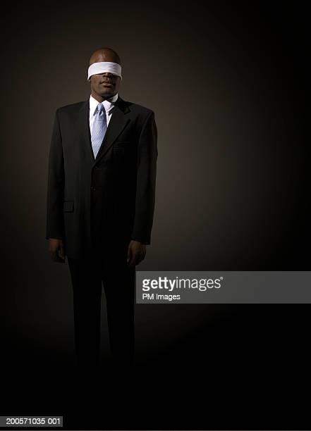 Businessman wearing blindfold